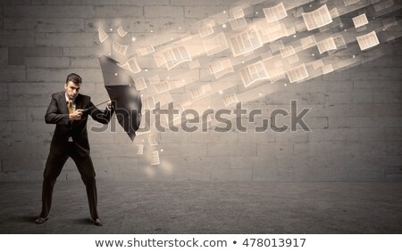 Crisis management. Business man protects against bankruptcy Stock photo © orensila