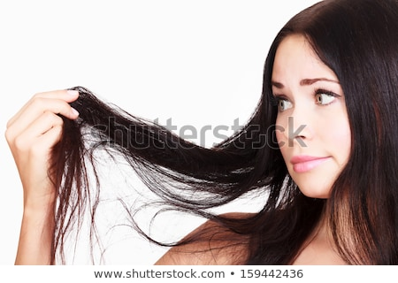 woman is not happy with her fragile hair, white background Stock photo © Nobilior