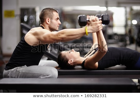 Woman working out with a physical trainer Stock photo © dash