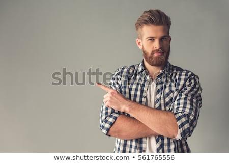 lezser · fiatalember · mutat · üres · hely · mosolyog · copy · space - stock fotó © dash