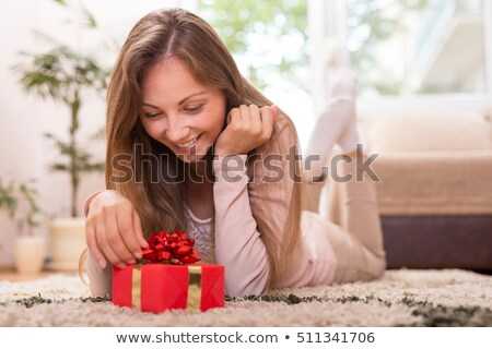Young woman getting her present on valentine's day Stock photo © deandrobot