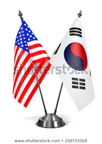 ABD Güney Kore minyatür bayraklar yalıtılmış beyaz Stok fotoğraf © tashatuvango