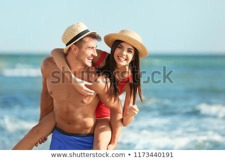 Belle couple plage vieux bateau femme Photo stock © PetrMalyshev