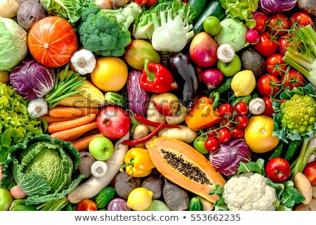 fresh fruits and vegetables on a wooden background stock photo © zerbor