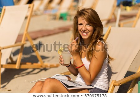 beautiful brunette woman relaxing and lying on the beach at suns stock photo © victoria_andreas