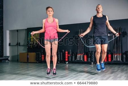 fitness · instructor · saltar · la · cuerda · blanco · mujer · nina - foto stock © dolgachov