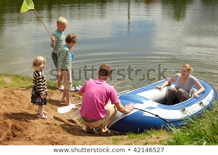 The family from five persons sits down in an inflatable boat Stock photo © Paha_L