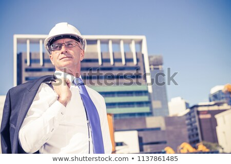 elegant senior engineer wearing glasses and helmet stock photo © feedough