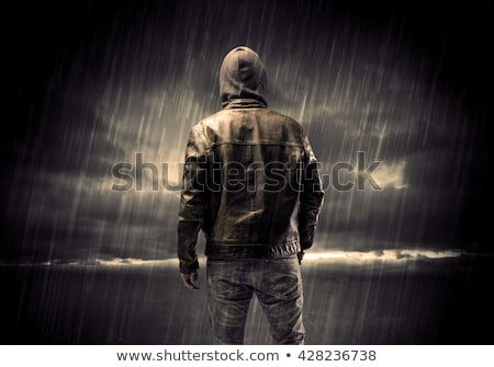 Dangerous unrecognizable faceless criminal standing in front of Stock photo © stevanovicigor