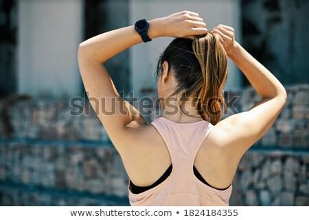 Shapely woman adjust hair Stock photo © filipw