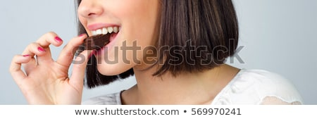 young woman enjoying cookie's taste Stock photo © Giulio_Fornasar