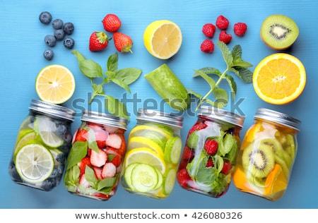 Víz detoxikáló uborka citrom gyümölcs háttér Stock fotó © M-studio