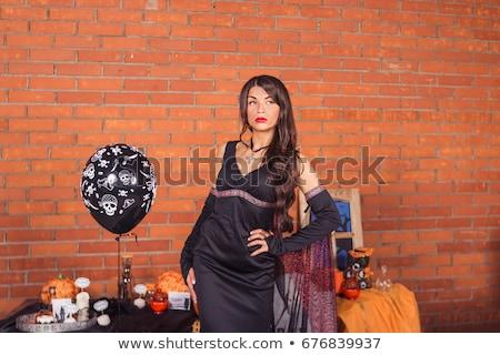 Cartaz sensual halloween bruxa roxo cabelos longos Foto stock © MarySan