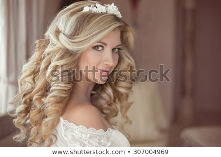 wedding portrait of beautiful smiling bride with long wavy hair stock photo © victoria_andreas