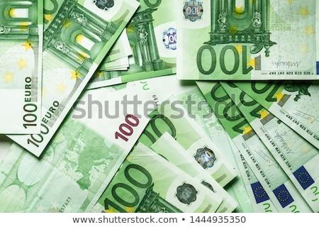 Banknotes 100 euros rolls. Stock photo © RuslanOmega