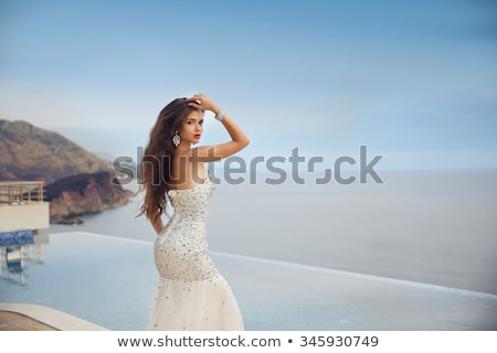 Beautiful long hair female model posing by the outdoor pool Stock photo © dashapetrenko