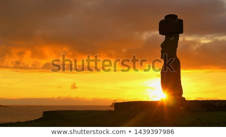 Sunset with a moai at Tahai, Easter island Stock photo © adrenalina