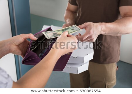 Woman Giving Us Dollar Note For The Pizza Stock photo © AndreyPopov