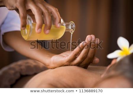 Woman enjoying Ayurveda oil massage in spa Stock photo © julenochek