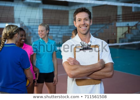 sorridente · treinador · em · pé · voleibol · tribunal · retrato - foto stock © wavebreak_media