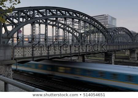 the hackerbruecke bridge in munich germany with moving train stock photo © haraldmuc