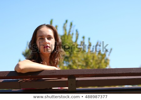 Young woman hiding behind the bust Stock photo © deandrobot