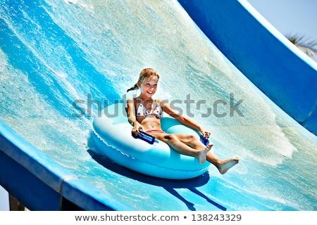 Menina deslizar parque aquático jovem lâmina de água férias de verão Foto stock © FOTOYOU