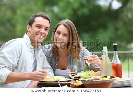 Couple having lunch in garden Stock photo © IS2