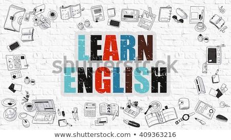 learn foreign languages on white brick wall stock photo © tashatuvango
