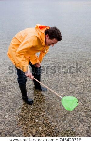 Férfi esőkabát halászat játék net természet Stock fotó © IS2