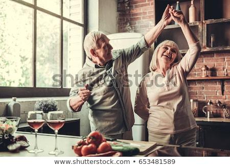 Idős pár tart borospoharak férfi pár jókedv Stock fotó © IS2