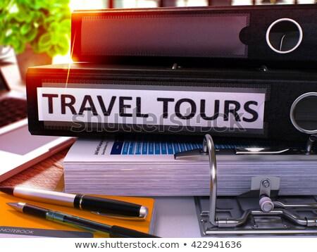 Black Office Folder with Inscription Travel Tours. Stock photo © tashatuvango