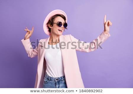 Genç güzel mutlu genç kadın pantolon askısı poz Stok fotoğraf © hsfelix