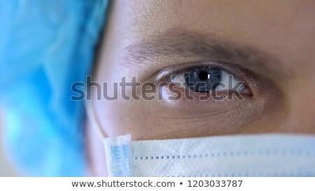 doktor · yukarı · ciddi · kadın · çalışmak · hastane - stok fotoğraf © stevanovicigor