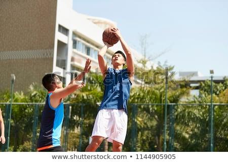 Kettő kosárlabdázó egy lövöldözés ugrik férfi Stock fotó © wavebreak_media