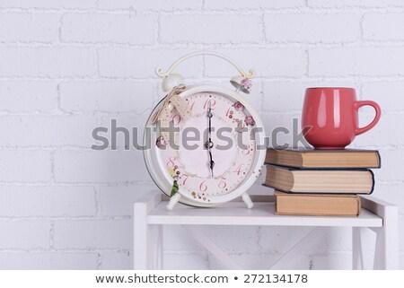 Alarm clock and stack of books Stock photo © wavebreak_media