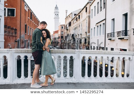 Venice couple embracing by canal Stock photo © IS2