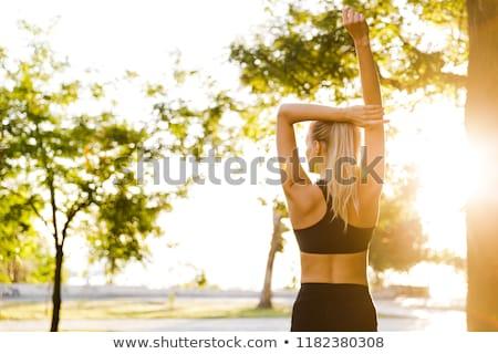 güzel · genç · sarışın · kadın · açık · havada · oturma - stok fotoğraf © deandrobot