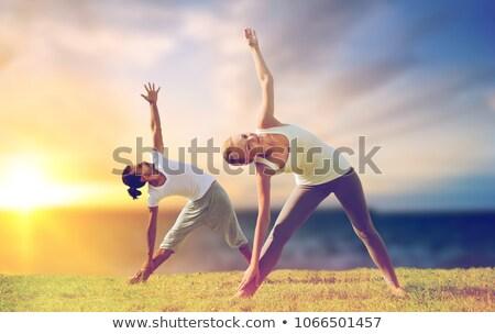 Casal ioga triângulo pose ao ar livre Foto stock © dolgachov