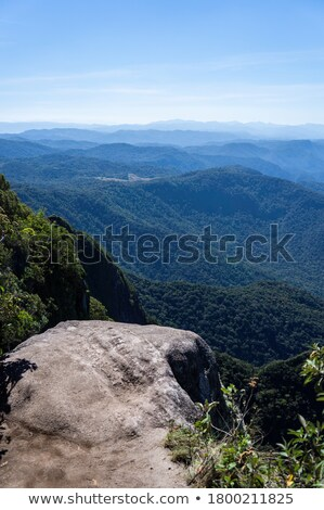 Relaxing with stunning cliff top views mountains and valleys Stock photo © lovleah
