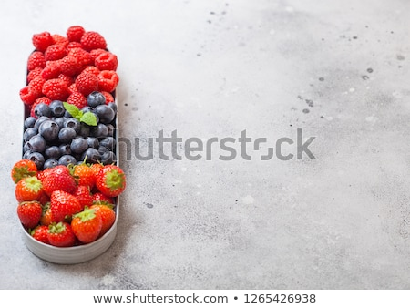 Fresh raw organic berries in in stainless steel tray on kitchen table background. Space for text. To Stock photo © DenisMArt