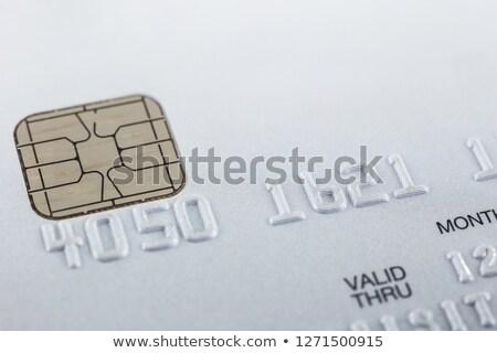 Silver credit card focus on embossed numbers. Stock photo © vinnstock