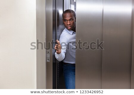 man stopping elevator door with his hand stock photo © andreypopov