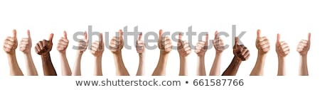 Successful businesspeople showing thumbs up sign Stock photo © Kzenon
