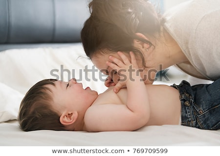 Mother and her son child taking good time on bed Stock photo © Lopolo