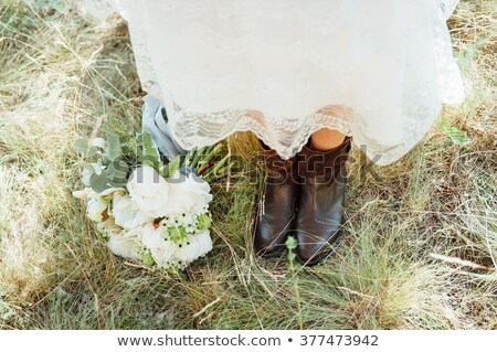 bridal bouquet close to her feet in the grass Stock photo © ruslanshramko