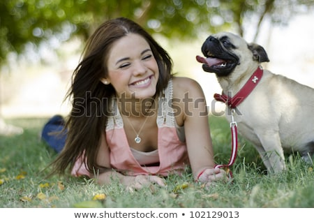 Pretty young woman spending time at the park Stock photo © deandrobot