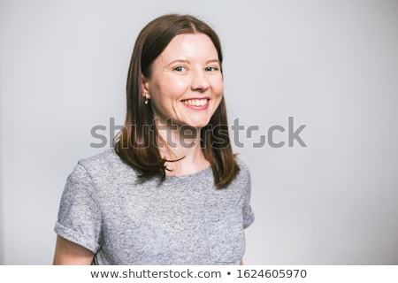 portrait of a woman with a long brown hair on gray background isolatad stock photo © lopolo