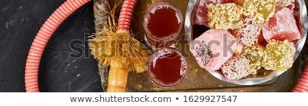 Set of various Turkish delight in bowl on metal tray near hookah tube stock photo © Illia