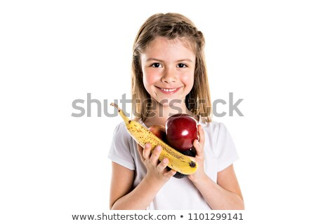 Portrait of a cute 7 years old girl Isolated over white background with apple, banana and avocado Stock photo © Lopolo